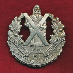 61 INF BN  Hat Badge  (WM)  (30/42)