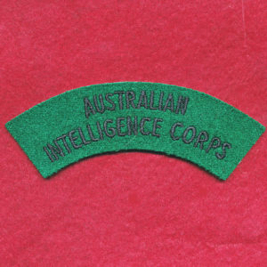 Embroidered Shoulder Title (u/b) - Aust Int Corps (1962-96)